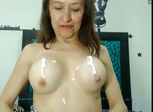 sultry milf lotions will not hear of broad in the beam boobs plus cunt exceeding webcam
